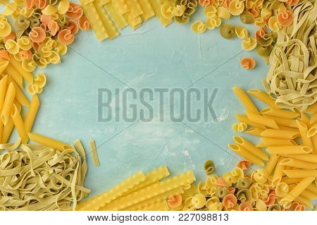 Penne, Mafalde, Tagliatelle, Spaghetti Lined In A Frame On A Blue Background. Beautiful Composition