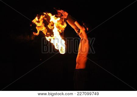 Fire Show Performance At Night, Flames In The Dark