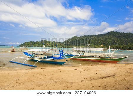 Traditional Philippine Boats On The Beach In Port Barton. The Island Of Palawan. Philippines.