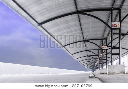 Perspective Of Large Outdoor  Parking Lot With Steel Tube Structure And Metal Sheet Roof And White W