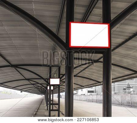 Empty White Board On Steel Tube Pole Of Parking Car
