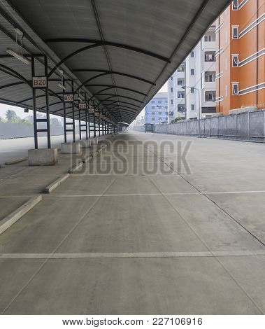 Perspective Of Outdoor Empty Parking Lot With Steel Tube Structure And Metal Sheet Roof Inside Many