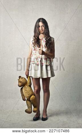 Grown up girl holding a teddy bear