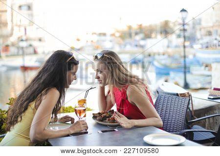 Girl chatting at the bar