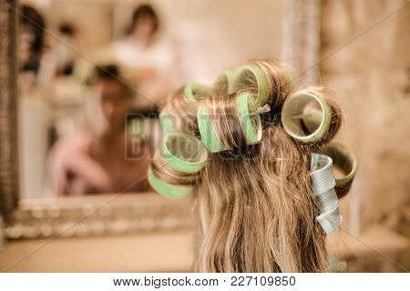 Blonde curls at the hair saloon