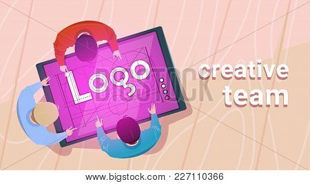 Creative Designers Team Working Sit At Desk Together Create Web Logo On Digital Tablet In Modern Off