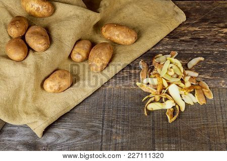 The Cook Cleans The Potatoes With A Knife Cook Clean The Potatoes