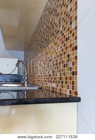 Sinks In Black Counter With Colorful Mosaic Wall In Kitchen Room