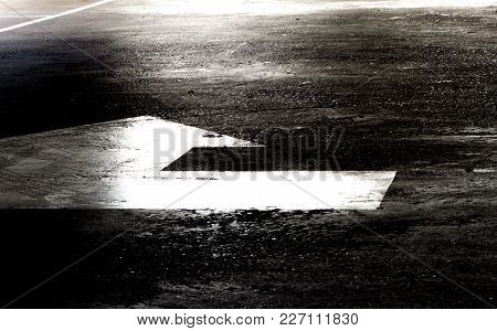 Light Effect Sign On Concrete Floor Of Parking Garage