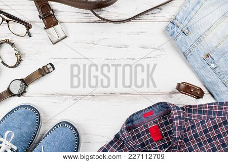 Men Stylish Casual Clothing And Accessories On Wooden Background. Top View