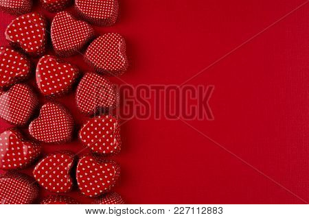 Decorative Border Of Red Hearts On Passion Red Paper Background. Valentine Day Backdrop.