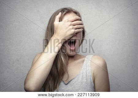 Terrified woman screaming