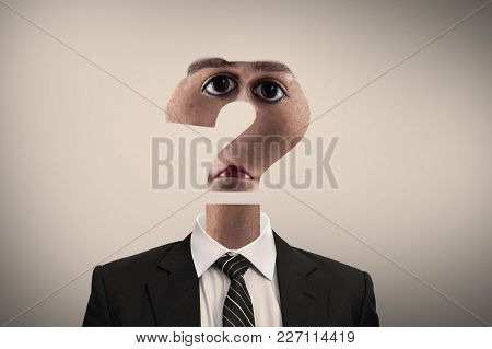 Business Man With His Head Shaped As A Question Mark Sugesting Confusion.