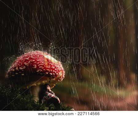 Young Woman Protect Herself From Rain Under A Mushroom.