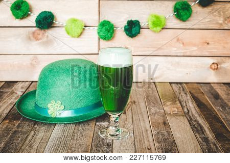 Glass Of Green Beer With Irish Festive Hat