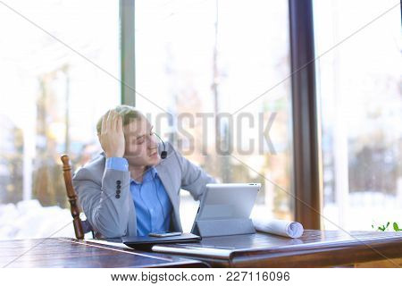 Engineer Browsing By Tablet And Sitting At Cafe With Smartphone, Roll Project And Black Document Cas