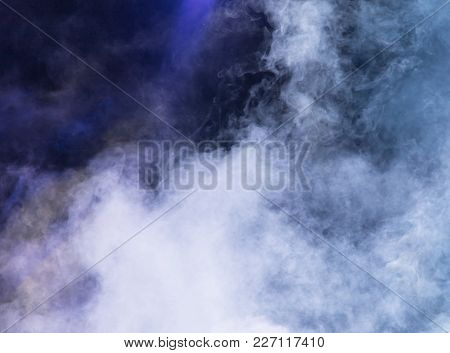 Multi-colored Smoke At The Concert At Night .