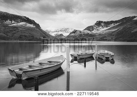 Beautiful  Black And White Winter Landscape Image Of Llyn Nantlle In Snowdonia National Park With Sn