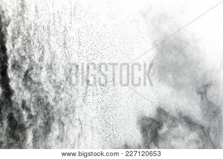 Particles Of Charcoal On White Background,abstract Powder Splatted Background,freeze Motion Of Black