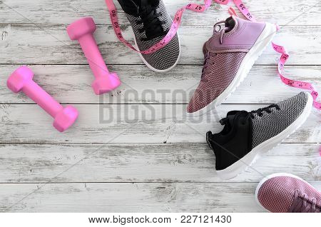 Womens Sport Bra And Sneakers On Wooden Background With Copy Space. Active Running (walking) Footwea