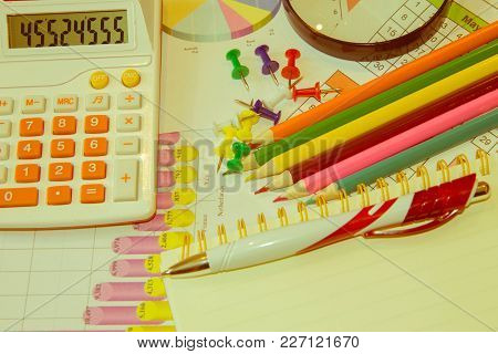 Close Up Business Concept, Calculator, Pencil, Pen On Financial Report On Table Office. Business Bal