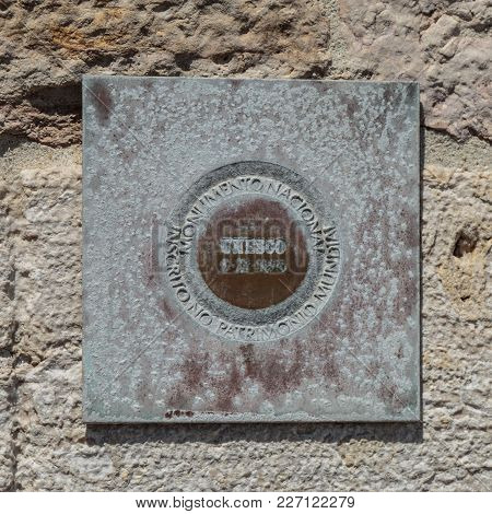 Bronze Unesco World Heritage Plaque Outside Of Belem Tower On The Tagus River In Lisbon, Portugal.