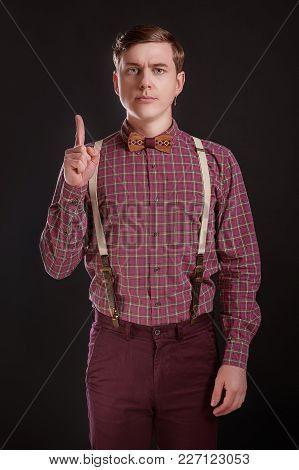 Attention! Strict Handsome Young Man In Vintage Shirt Bow Tie Keeping Finger Raised And Looking At C