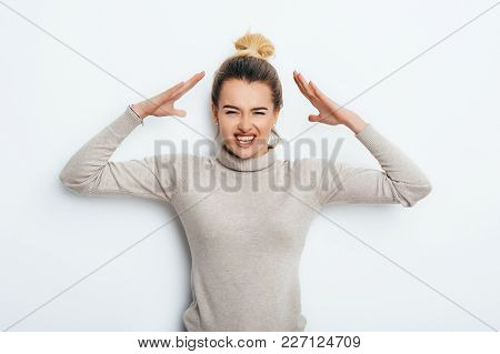 Close Up Isolated Portrait Of Young Annoyed Angry Woman Holding Hands In Furious Gesture. Negative H