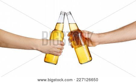 Female And Male Hands With Cold Beer Bottles, Isolated On White Background. Beer Up. Cheers. Pair Of