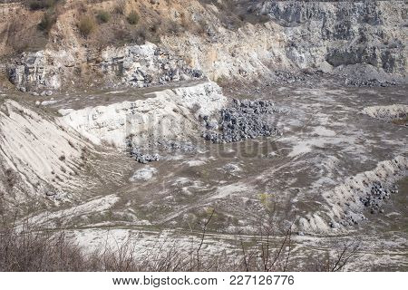 Beautiful View Of The Huge Limestone Quarry. There Is Early Spring On This Image.