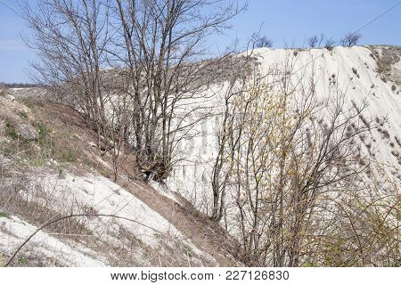 Beautiful View Of The Limestone Quarry. There Is Early Spring On This Image.