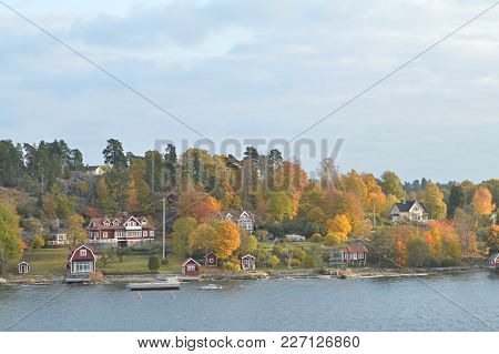 Small Island In Sweden With Nice Small Red Houses In Autumn