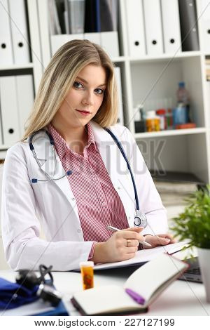 Beautiful Smiling Female Doctor Hold Clipboard Pad And Fill Something With Silver Pen. Physical Illn