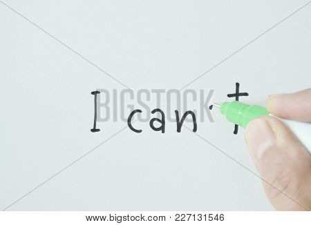 Finger Holding Correction Pen Delete Letter On White Paper