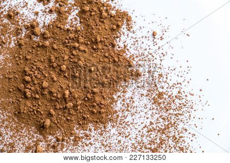 Pile Cocoa Powder In A Scoop Isolated On White. Heap Of Fresh Of Chocolate Studio Shot