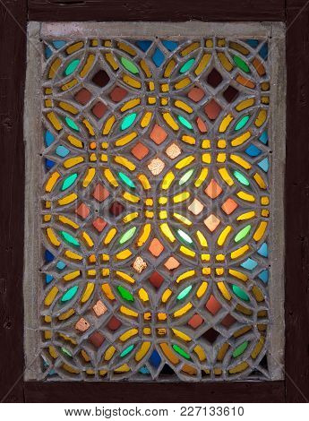Perforated Stucco Window Decorated With Colorful Stain Glass With Geometrical Circular Patterns, One