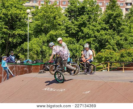 St. Petersburg, Russia - 15 June, The Teen Performs A Trick, 15 June, 2017. Teenagers On Bicycles In
