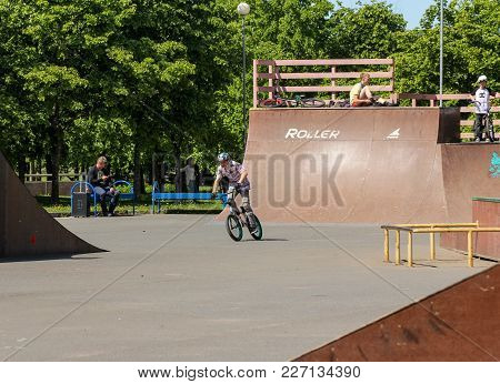 St. Petersburg, Russia - 15 June, A Cyclist Between The Slides, 15 June, 2017. Teenagers On Bicycles