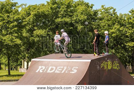St. Petersburg, Russia - 15 June, A Teen Performs A Trick On A Bicycle, 15 June, 2017. Teenagers On