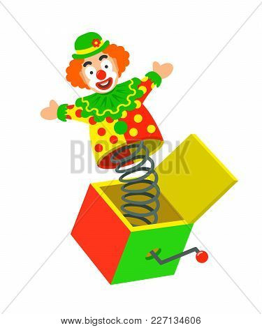 Toy Circus Clown On A Spring Pops Out Of A Box. Surprise Joke For April Fools Day. Jack In A Box Toy