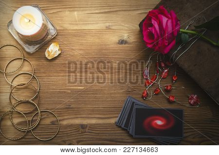 Tarot Cards And Book Of Magic On Fortune Teller Desk Table Background. Love Divination Concept.