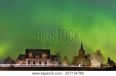 The Green Northern Lights Over The Church Of Frösön In
