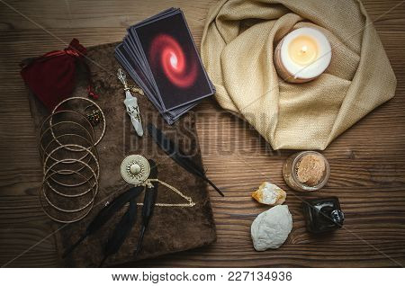 Tarot Cards Deck And Book Of Magic On Fortune Teller Desk Table Bakground. Future Reading Concept.