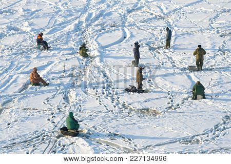 Group Of Fishermen On Winter Fishing On Ice Of The Gulf Of Finland