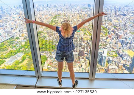 Aerial View Of Osaka Skyline In Japan. Travel And Tourism Asia Concept. Youg Caucasian Tourist Woman