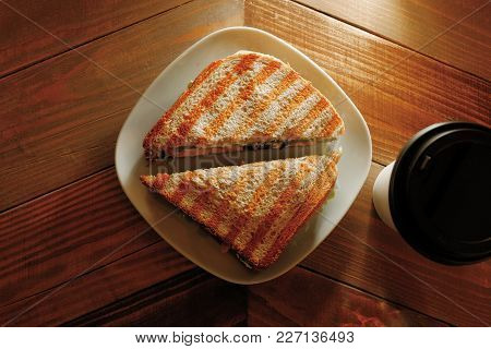 Cup Of Take Away Coffee And Sandwich On Plate From Above View