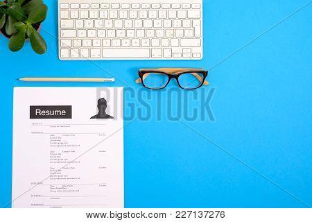 Cv Application Form On A Blue Desktop.top View