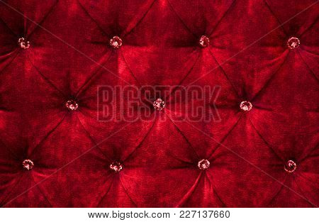 Red Diamond Pattern Velvet Upholstery Background. Beautiful Luxury Fabric Texture With Buttons