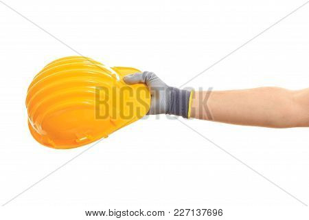 Health And Safety. Hand Holding A Hard Hat On White Background