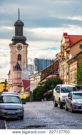Empty Street Of Old Town On Summer Evening. Cobblestone Pavement On The Ground. Beautiful Scenery Wi